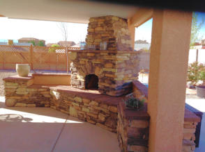 Kiva Fireplace with rock facing in patio by Mountain Paradise Landscaping, Rio Rancho & Albuquerque, New Mexico
