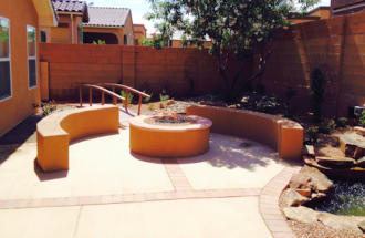 Fire pit patio with benches, bridges and water features by Mountain Paradise Landscaping, Rio Rancho & Albuquerque, New Mexico