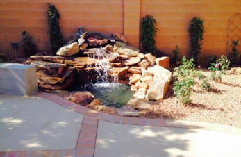 Moss rock waterfall and pond landscaping water feature by Mountain Paradise Landscaping, Rio Rancho & Albuquerque, New Mexico