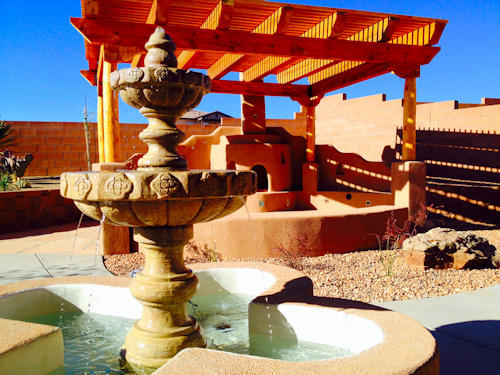 Fountain water feature wtih Kiva Fireplace under pergola by Mountain Paradise Landscaping, Rio Rancho & Albuquerque, New Mexico